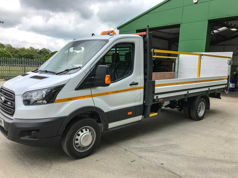 L4 alloy bodied dropside with tail lift for hire